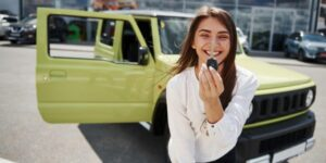 Lady buying used car holding key in hand