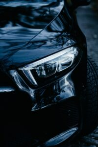 Close Up Of Black Car Bumper and Front Headlight