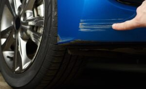 Blue Car with Scratches