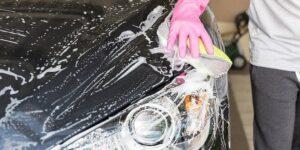 Person Washing Black Car